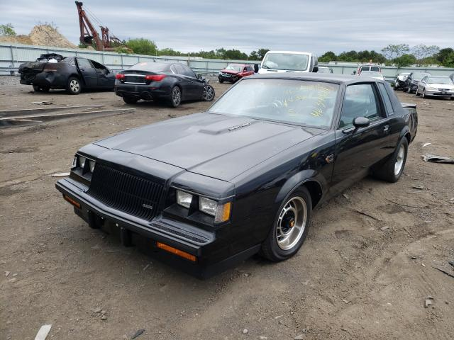 An all black Buick Regal Grand National coup sits in a Copart yard.