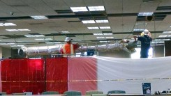 Workers removing pipe.