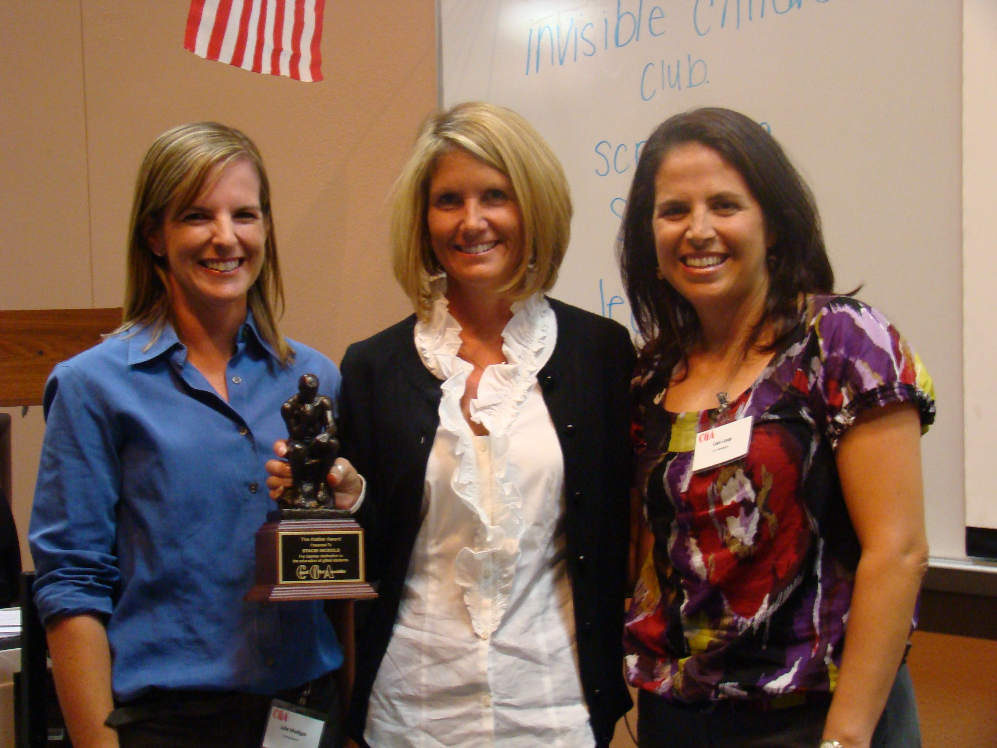 CGA Co-Presidents Julie Madigan and Lian Loop with Kettler Award Winner Stacie Nickols (center)