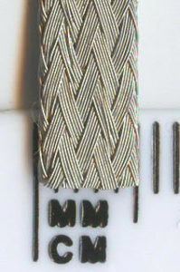 Tinned copper braid suitable for inlaying into custom built slot car tracks. Hard wearing 0.1mm diameter copper wire woven into a flat, 5mm wide braided tape. It bends in any direction to allow for hills, dips and flat curves in your track.