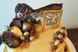 The top of a Bespoke Music Themed Chocolate, Caramel and Vanilla Cake