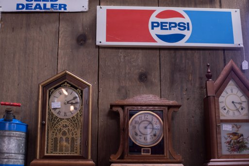 Dutch Lady Antiques Clocks and Pepsi Sign