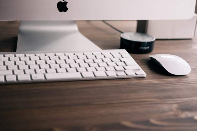 Photo of mac keyboard and mouse, courtesy Tetsuya Tomomatsu via Unsplash