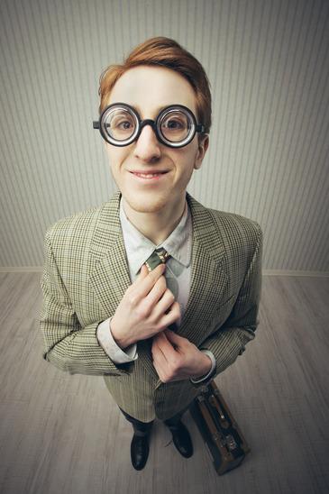Salesman smiling adjusting tie
