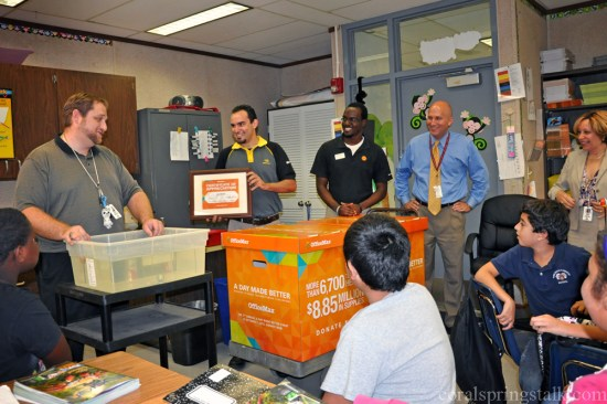 Teacher David Mankes gets a surprise from OfficeMax today during his lesson.