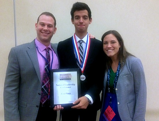 Student Leonardo Gutierrez receives his First Place at BPA.  Pictured with advisors Jason Freedman and Jacqueline Coll