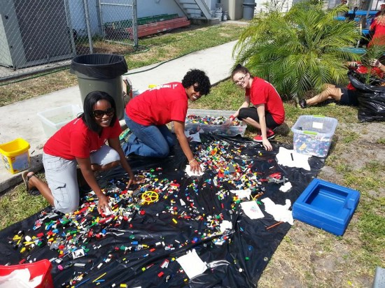 Keller Williams Realty associates washing legos for the updated room at the Boys and Girls Club of North Lauderdale