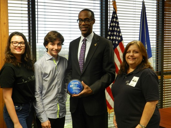 EF High School Exchange Year Regional Coordinator Laura Barry (far right), accompanied by EF exchange students Anna-Lea Fischer from Germany and Paolo Bellentani from Italy, presenting the 2013/14 Global Education Excellence Award to Superintendent Robert W. Runcie for the District's support of international exchange.