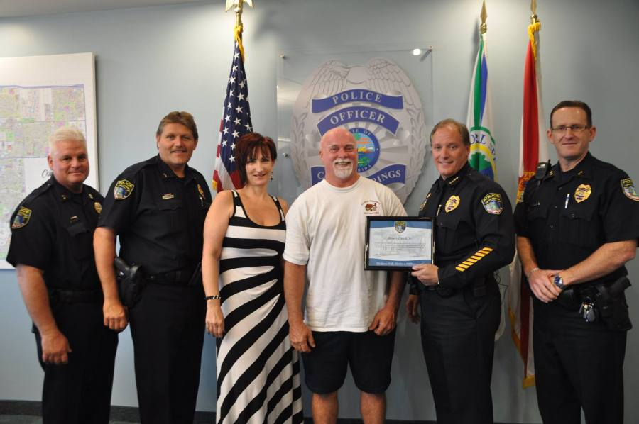 Chief Tony Pustizzi and his command staff presented Mr. Lynch with the Make a Call, Make a Difference plaque of appreciation.