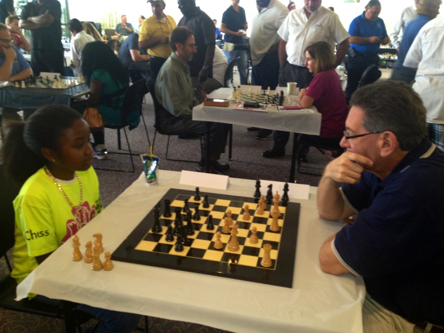 Laurderhill Mayor Richard Kaplan is challenged to a game of chess