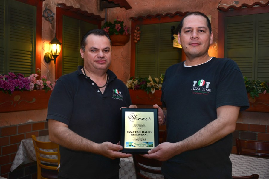 Congratulations to Pizza Time Owner Joe Russo (left) with waiter Jose Waiter