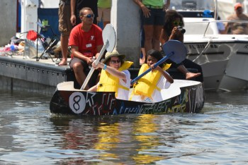Students from Marjory Stoneman Douglas race in the Plywood Regatta