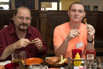 Glenn Siegel and his son Jonathan taste the wings at Lefty's Tavern and Grille.
