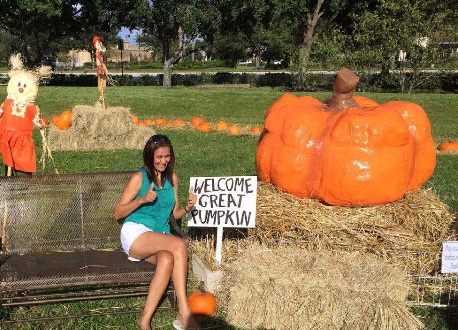 "Chris Darling at the ""selfie statin"" next to her Great Pumpkin creation"