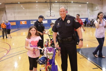 Chief Pustizzi with bicycle recipient