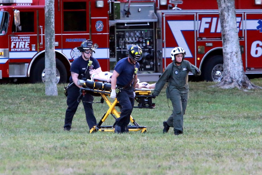 Paramedics transport victim of stabbing to air rescue. Photo by Jim Donnelly