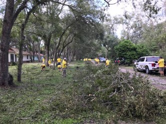 Members of the Coral Springs Church of Jesus Christ of Latter-Day Saints help clear the mess left behind after Hurricane Matthew.
