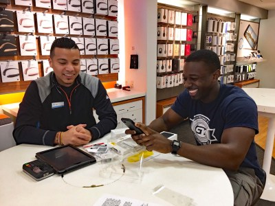 Henry working with AT&T Coral Springs sales consultant Jhan Quintero to get his new iPhone 7 set up