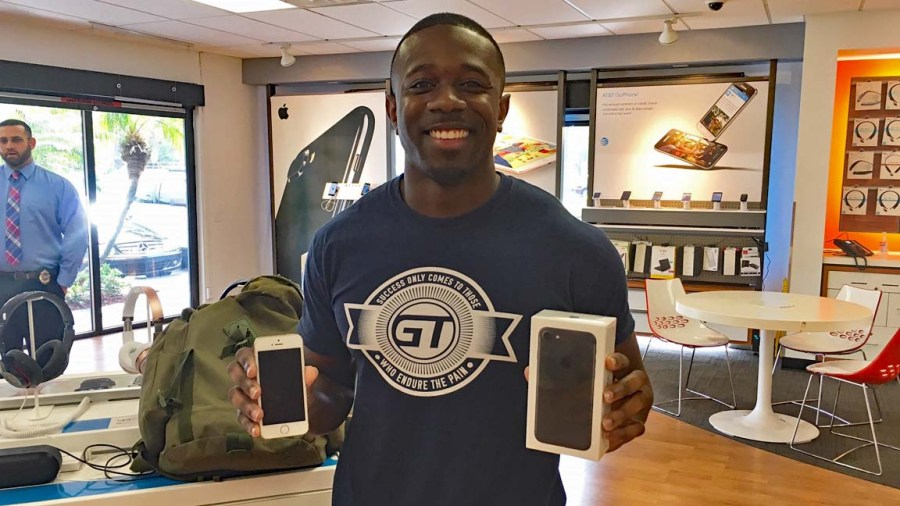 Henry holding his water damaged iPhone 4 in one hand (left) and his new, much larger, iPhone 7 in the other hand.  Photos Courtesy AT&T.
