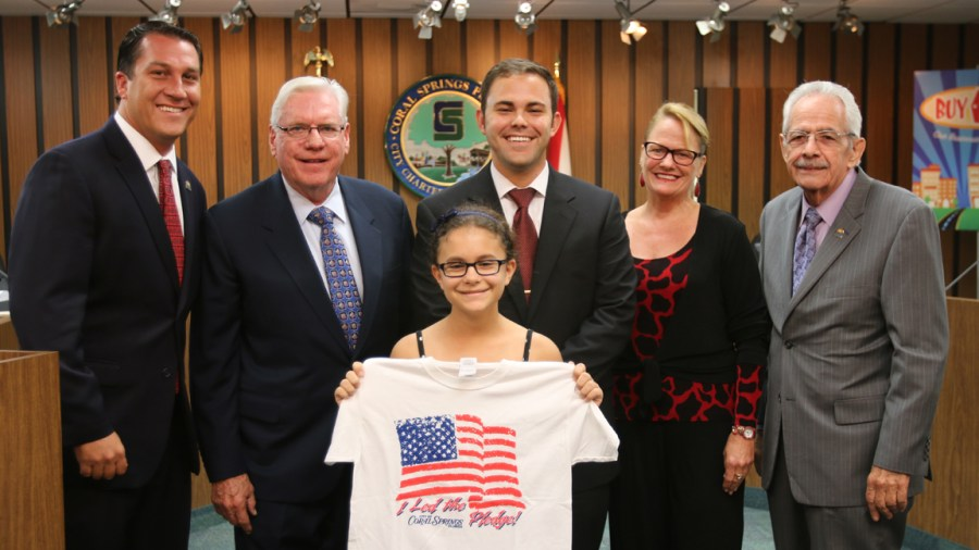 Commissioner Larry Vignola, Mayor Skip Campbell, Vice Mayor Dan Daley and Commissioners Joy Carter and Lou Cimaglia with a student.