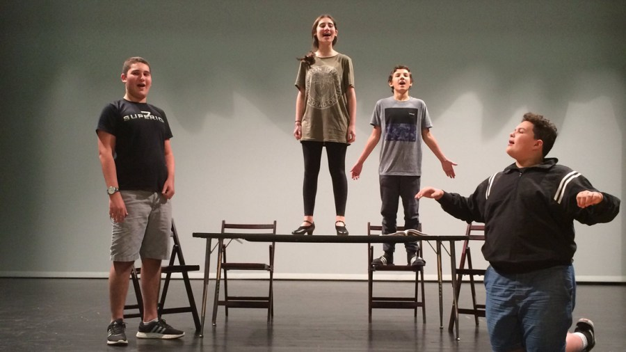 """Cast members at Marjory Stoneman Douglas rehearsing for """"Annie""""."""