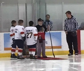 Michael Weiner dropping the opening puck at the game. Photo by: Lissette Rozenblat