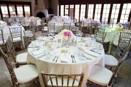 Off White Table Setting with Hints of Pink in the Centerpiece and Menu