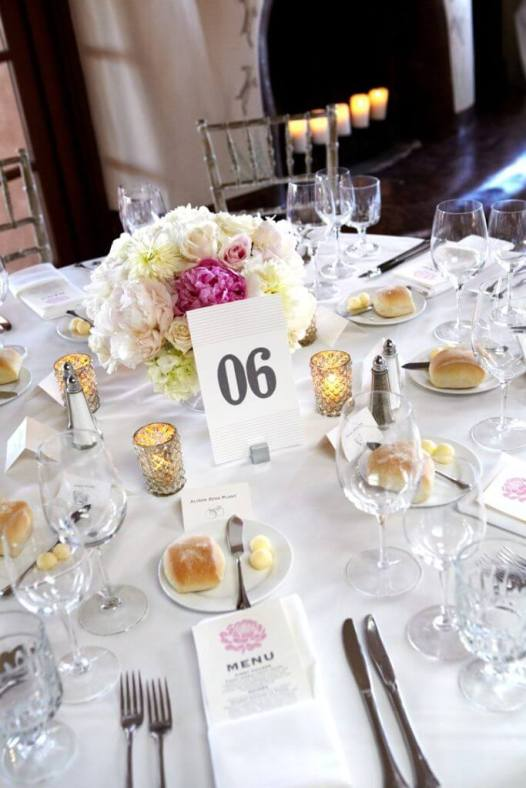 White Table Setting with Candles and White and Pink Roses