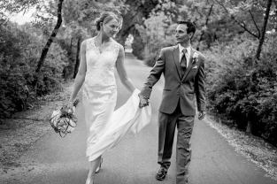 Bride and Groom Walk Hand in Hand Down The Path of Life Together