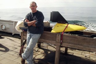 NOAA Fisheries scientist Jon Hare with a video plankton recorder—a device that scientists use to measure the distributional patterns of live plankton.