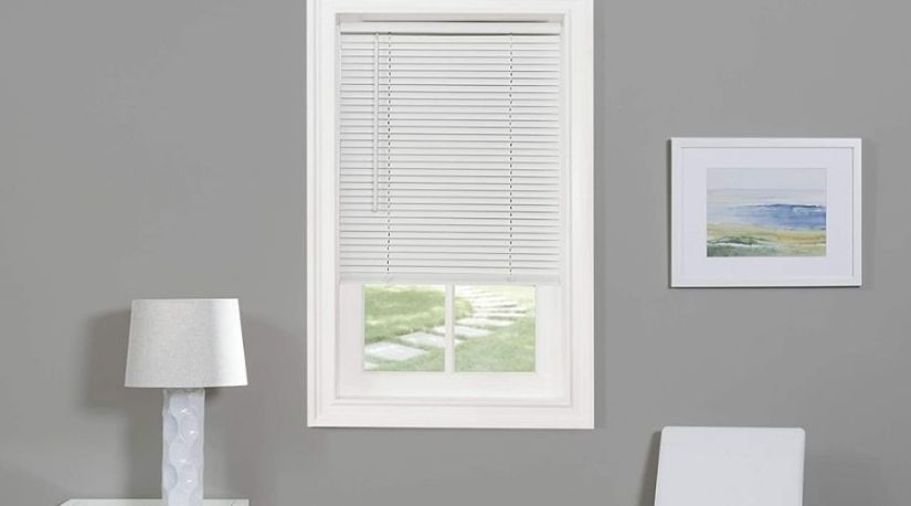 How to fix levelor cordless blinds: The image shows a cordless blind in use in a home toregulate lighting in a living room