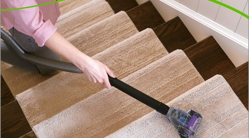An image of BISSELL 2252 CleanView Swivel Upright Bagless Vacuum Carpet Cleaner, one of the best cordless vacuum cleaners in use to clean wooden floor
