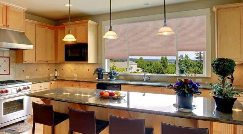 """An image of Redi Shade Easy Lift Trim-At-Home Cordless Pleated Light Filtering Fabric Shade (Fits Windows 19""""-30""""), 30 Inch x 64 Inch, Natural, one of the best cordless cellular shades in use to regulate light and for security in kitchen windows"""