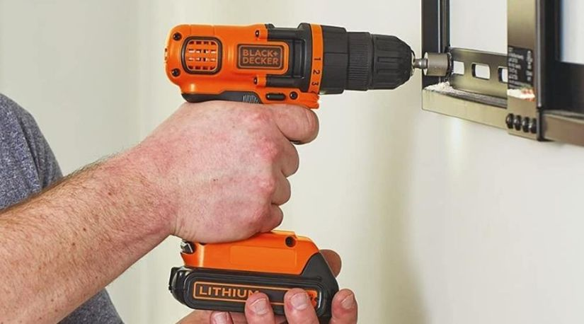An image showing a man holding BLACK+DECKER 20V MAX Cordless Drill / Driver, 3/8-Inch (LDX120C) in 11 clutch positions and drilling in the screws into a metal surface