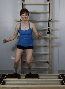 Betsy Walker demonstrating an exercise on the CoreAlign® to simulate skiing