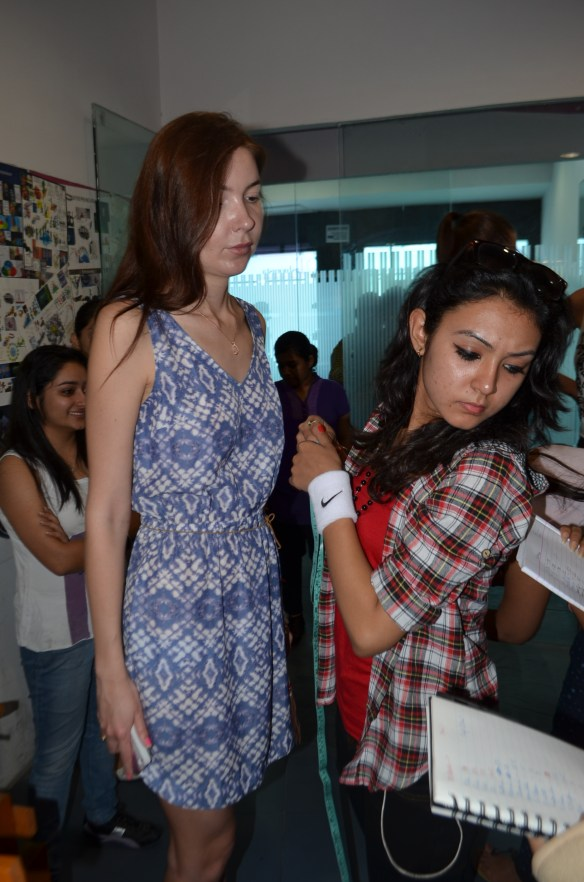 Students with International Models Taking Measurement for Fashionista Fashion Festival