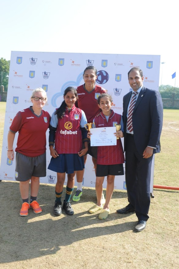 Jade Richards (Defender Aston Villa Football club) Ravinder Masih(Head of AVFC community) with the best two players s_