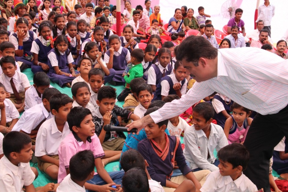 Enthusiastic students participating in a quiz competition at Karanjoti village  Thane  Mumbai