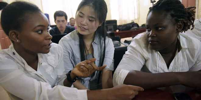 A Chinese language teacher speaks with students at the Confucius Institute at the University of Lagos