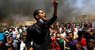 A Sudanese demonstrator at a protest in the capital Khartoum. Ashraf Shazily/AFP via Getty Images