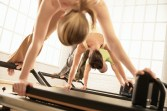 STOTT Reformer Snake Exercise Group