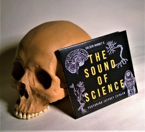 A skull with the CD, The Sound Of Science