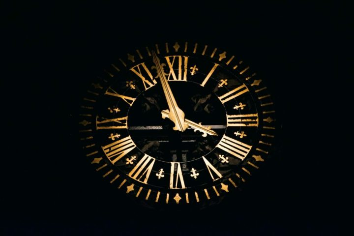 round black and brown analog clock