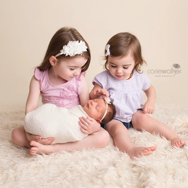 newborn girl with big sisters