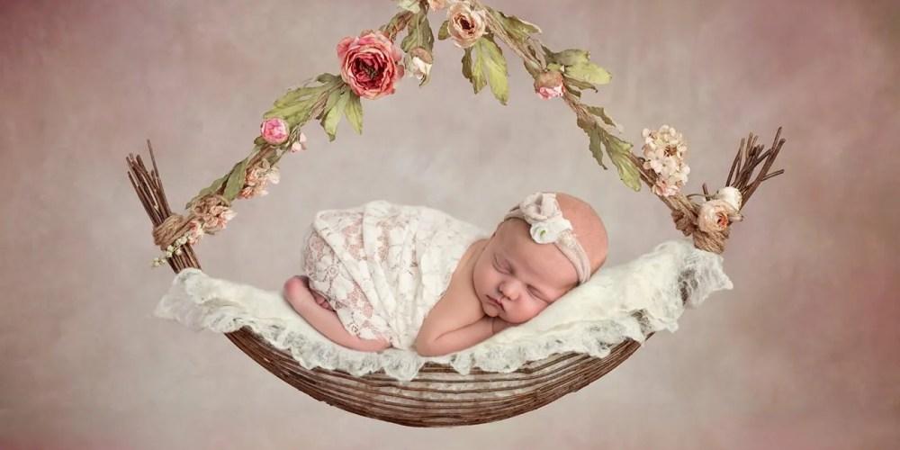 newborn hanging from swing