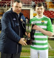 Barry Kelleher, Macroom B, receives the President's Cup from Kevin O'Mahony - 2017