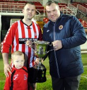 Trevor Dunlea, Kilreen Celtic receives the Mossie Linnane League Cup for 2015/16 from Kevin O'Mahony (Cork AUL)