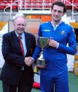 Dan Gallagher (Strand United) receives the County Cup from Martin Conlon (Cork AUL)