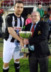 Donoughmore Athletic captain, Aidan O'Shea receiving the Murphy's Stout Corinthian's Cup from Henry Healy, Cork AUL