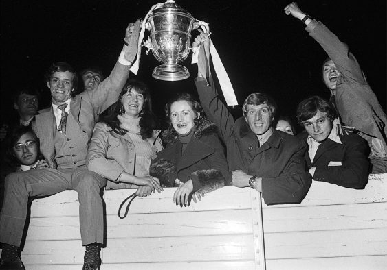 Jubilation as Cork Hibernians hat-trick hero Miah Dennehy (left) and player/manager Dave Bacuzzi hold the FAI Cup aloft after their historic win at Dalymount Park on April 23rd, 1972 when they defeated Waterford
